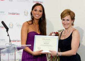 "Maya Olesen, Miss World Denmark (left) presenting The Xara Palace Relais & Chateaux Director Nicola Paris with runner-up for ""Best Dining Boutique Hotel in the World"" at The 2012 Boutique Hotel Awards held at the Hempel Hotel in London."