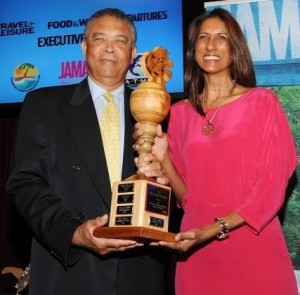 Caribbean publisher Neysha Soodeen (right) is congratulated by Donnie Dawson of the Jamaica Tourist Board