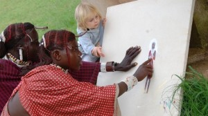 maasai-warriors-painting-with-child
